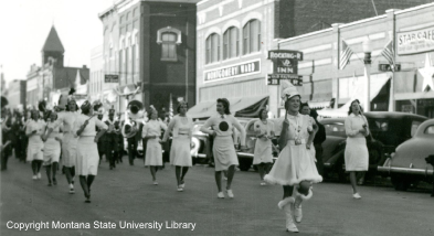 Historic photo of the MSU Parade in front of the Rocking 'R' Bar