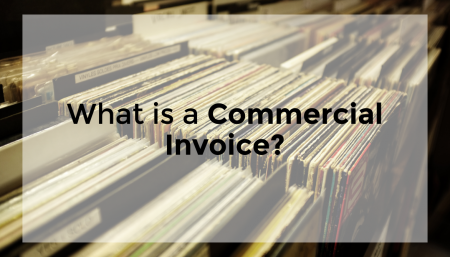 A stack of files with the text 'what is a commercial invoice' displayed
